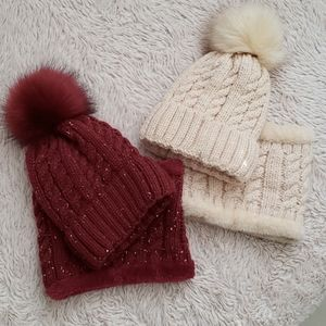 Bundle of knitted hats and neck warmers